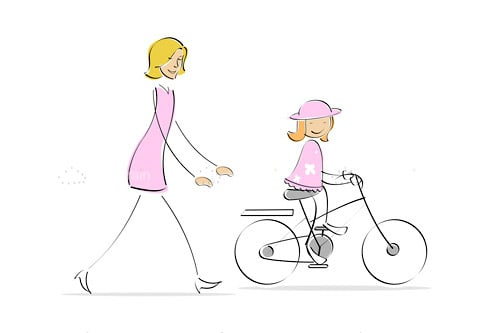 Mother running behind girl cycling